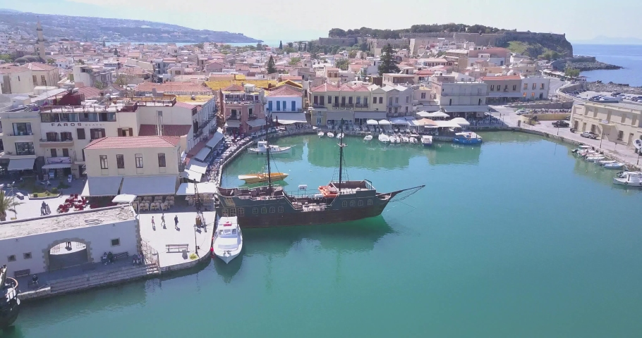 Venetian Harbour, Rethymnon, Crete, Greece – April 16 2016: The Venetian Harbor of Rethymnon, next to the modern harbor of the city, with the Egyptian lighthouse. | Shutterstock HD Video #1041631615