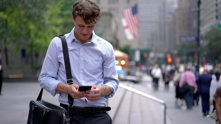 Male professional with leather briefcase for corporate documents standing at street area and using 4g for checking financial situation of money exchange, Caucasian businessman making online banking  | Shutterstock HD Video #1041631951