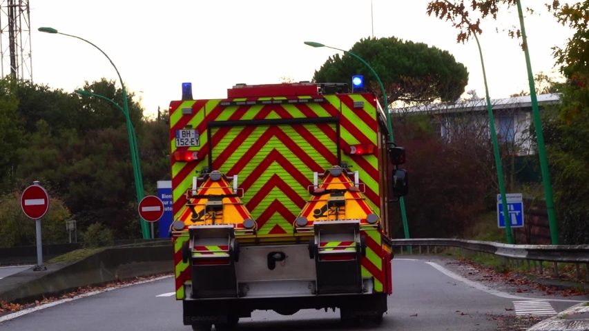 12.11.2019 Toulouse France: Red French fireman truck , first rescue van rushing along the street and turns onto the expressway