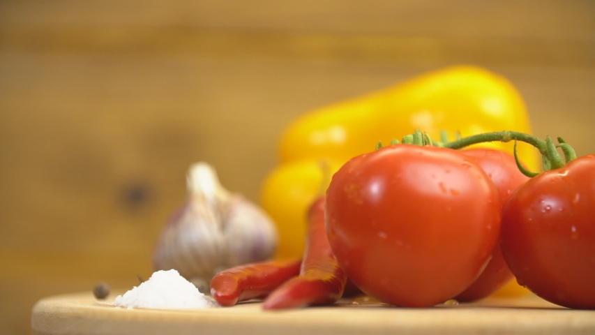 Tomatoes and peppers on a spinning wooden tray | Shutterstock HD Video #1041649015