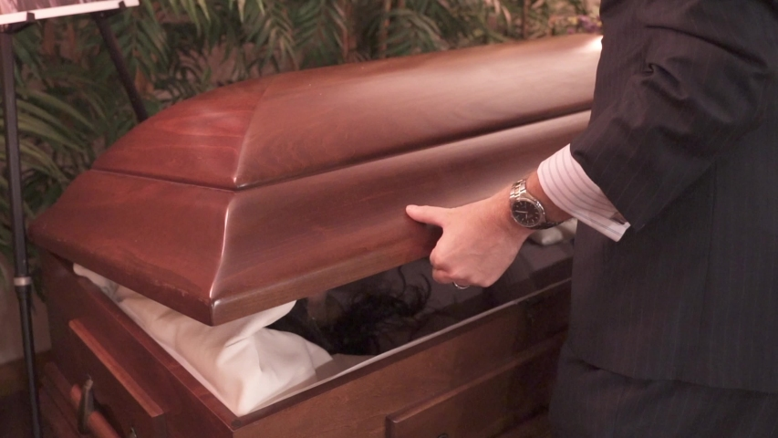 Funeral Director Man Closing Casket in Slow Motion. Coffin Closing at a Funeral