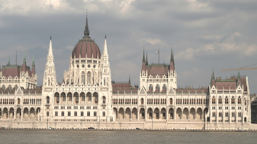 Pan left of the hungarian parliament in budapest, hungary | Shutterstock HD Video #1041668692