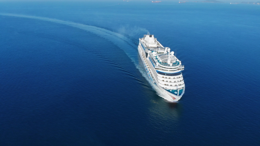 Aerial view of beautiful white cruise ship above luxury cruise in the ocean sea  concept tourism travel on holiday take a vacation time on summer. | Shutterstock HD Video #1041668953