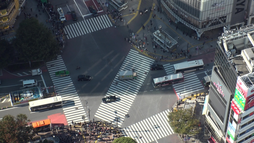 SHIBUYA, TOKYO, JAPAN - CIRCA NOVEMBER 2019 : Aerial high angle top view of SHIBUYA scramble crossing in day time. Crowd of people at the busy street. Japanese business and lifestyle concept. #1041670993