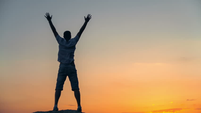 Success achievement running or hiking accomplishment business and motivation concept with man sunset silhouette celebrating arms up raised outstretched trekking climbing running outdoors in nature   Shutterstock HD Video #10416710