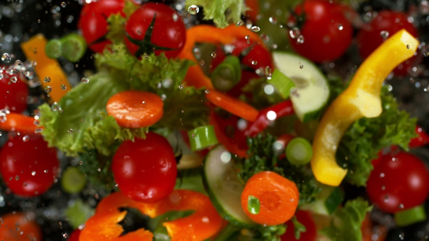 Fresh vegetables with water droplets exploding on black background. Filmed on high speed cinema camera, 1000fps. | Shutterstock HD Video #1041679915
