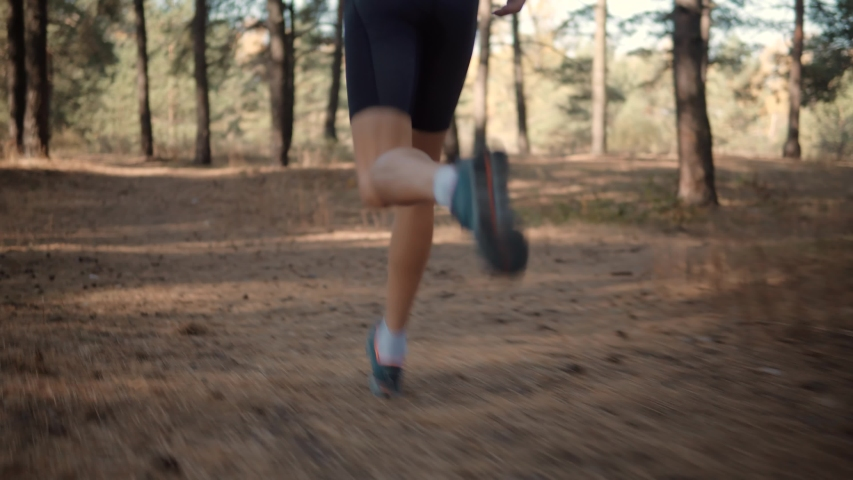 Running Man At Fall Park.Runner Man Fit Athlete Legs Jogging On Trail Ready To Triathlon.Triathlete Running,Sprinting And Endurance Workout Training.Marathon Runner Jog On Trail.Jogger Sport Concept | Shutterstock HD Video #1041680023