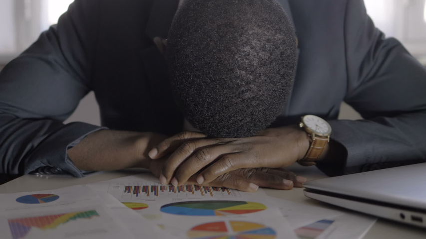 Desperate stressed black business man in his office. Stress,Business,frustration | Shutterstock HD Video #1041688165