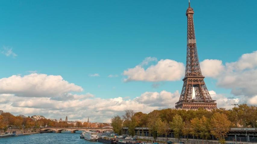 Amazing timelapse of the Eiffel tower  from Bir-Hakeim bridge, over the river Seine , Paris, France, at a cloudy but sunny autumn day | Shutterstock HD Video #1041689779