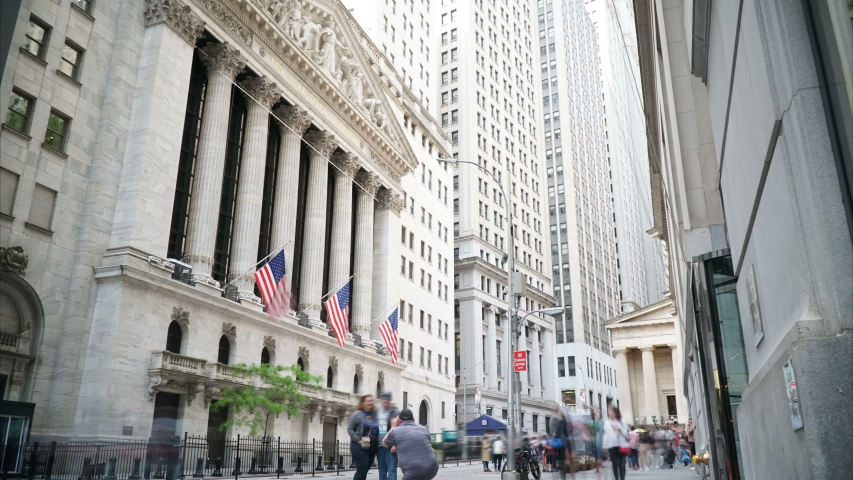 New York City, USA - Circa May 2019: New York Stock Exchange and the Wall Street Financial District visitors in a 4k Timelapse