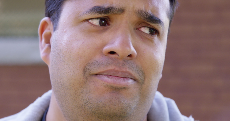Close Up - Indian man cries into the camera hopelessly - Slow Motion - shot on RED #1041710968