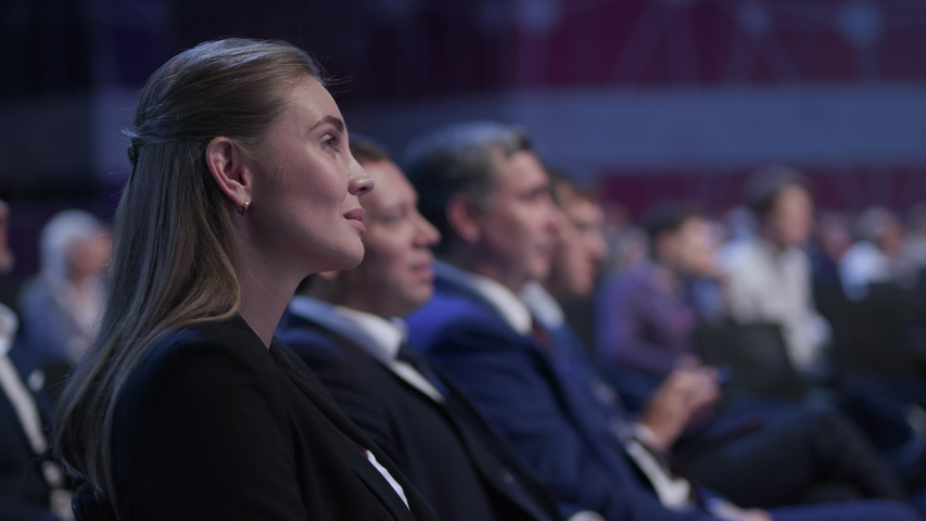 Business Meeting at Conference or Crowded Political Summit. Caucasian People Smile at Speaker Speech. Economic Briefing and Information for Success Strategy for Businesswoman. Row of Seats at Congress Royalty-Free Stock Footage #1041720427