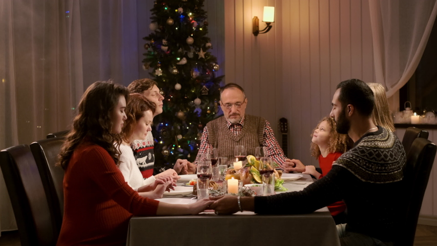 New Year. Served Holiday Table. All Generations Of Grandparents, Children And Grandchildren. New Year Holiday. Family Praying Before Food Holding Hands. #1041733435