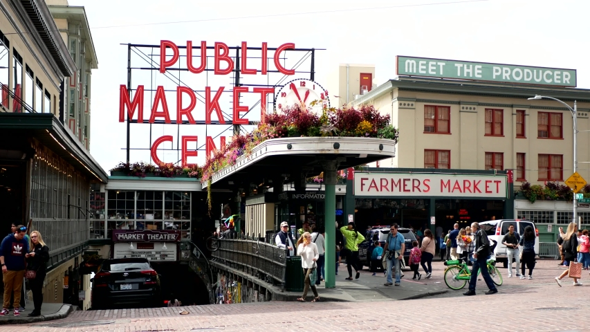 Seattle, Washington/USA - September 8, 2019 - People walking in front of Public Market Center in Pike Street. Streets of Seattle, cars and people. Selective focus