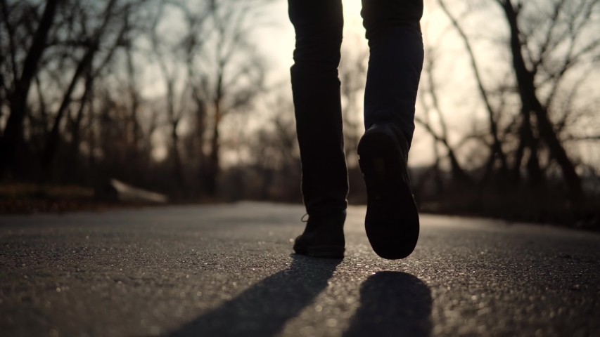 Confidence Man Feet Walking On Road At Sunrise.Lonely Handsome Guy Rest On Holiday.Man Legs Walking On Park. Businessman Legs On Sneakers Relaxing At Fall.Male In Leather Shoes Walk On Autumn Road.   Shutterstock HD Video #1041752383