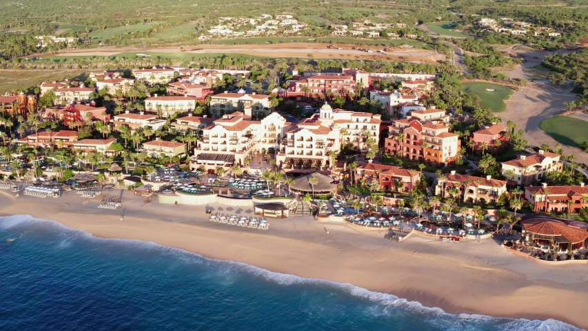 Aerial View of Waterfront of Cabo San Lucas, Baja California Mexico. Upscale Hotels Condos and Villas by Sandy Beach and Pacific Ocean | Shutterstock HD Video #1041754294