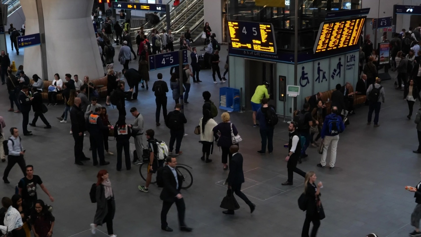 People waiting around a station in slow motion | Shutterstock HD Video #1041765358