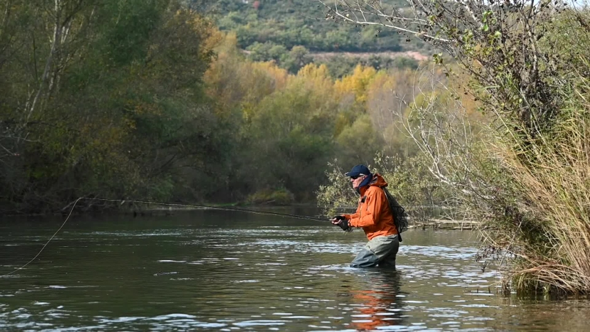fly fisherman in river in autumn #1041774475