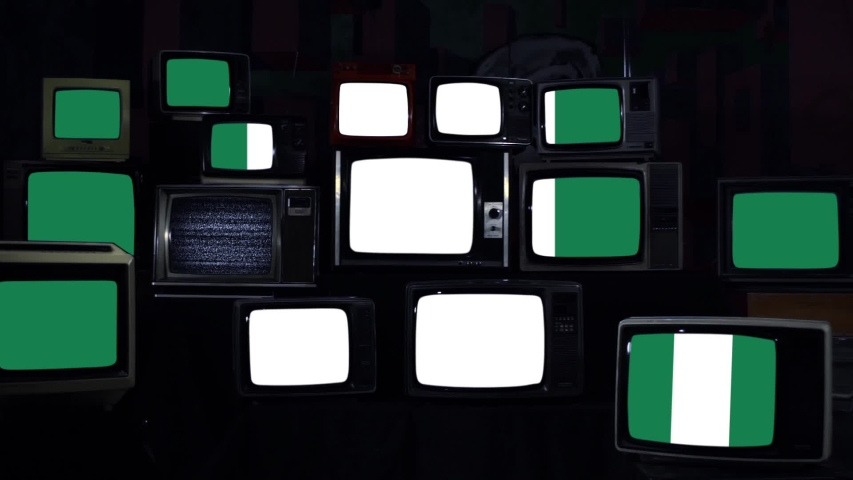 Flag of Nigeria on Old Retro Televisions with Noise. Zoom In Shot. Blue Dark Tone.   | Shutterstock HD Video #1041817849