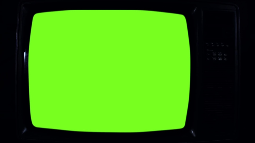 "Old Retro TV Turning On Green Screen with Color Bars. You can Replace Green Screen with the Footage or Picture you Want with ""Keying"" effect in After Effects (check out tutorials on YouTube).  