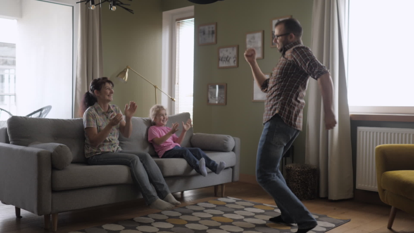 Family Funny Leisure Activity. Happy Parents and Cute Funny Kids Dancing Laughing in Living Room. Mom And Dad With Little Children Having Fun together. Love Lifestyle Home. Slow Motion. | Shutterstock HD Video #1041823831