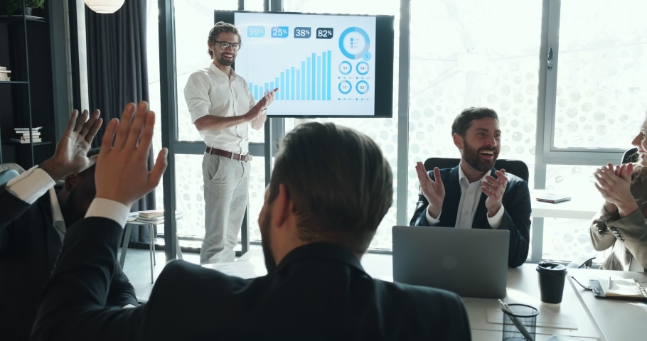 Attractive Leader of the Corporate Standing by the Interactive Board making Presentation of Project. Successful Teamwork. Business People Applauding sitting in the Meeting Room. | Shutterstock HD Video #1041848071