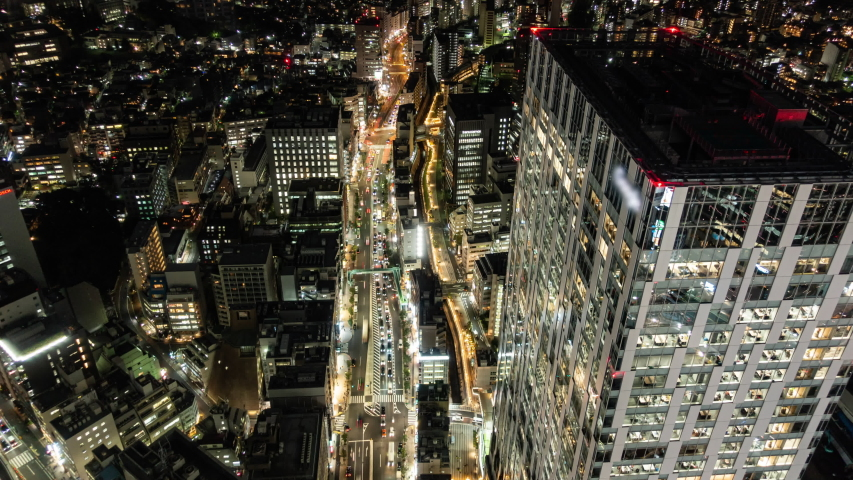 Big City Traffic at Night (time lapse/zoom in) | Shutterstock HD Video #1041860911