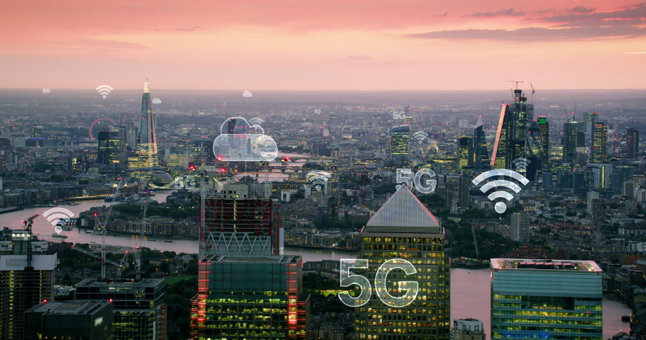 Futuristic city connected through 5G. High tech vision of London. Wireless network, mobile technology concept, data communication, cloud computing, artificial intelligence, internet of things. Red 8K. Royalty-Free Stock Footage #1041866518