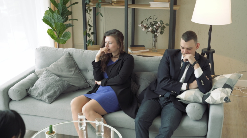 Unhappy young couple visiting professional marital therapist. | Shutterstock HD Video #1041869527