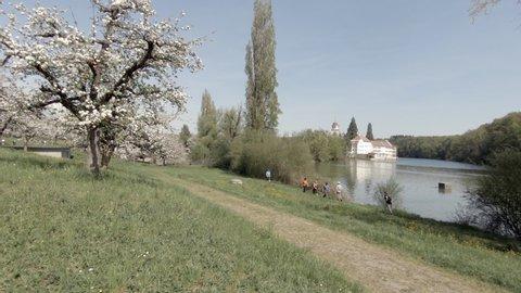 RHEINAU, SWITZERLAND - APRIL 4, 2018: The spring landscape in Rheinau with its benedictine abbey on the island
