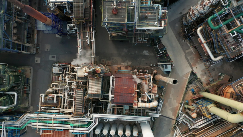 Aerial view. Top down view over power plant with many pipelines. | Shutterstock HD Video #1041904828