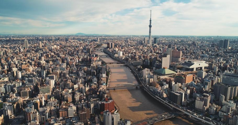 Aerial shot of Skytree and Ryogoku Kokugikan with Edo-Tokyo Museum in Tokyo city, Japan | Shutterstock HD Video #1041916858