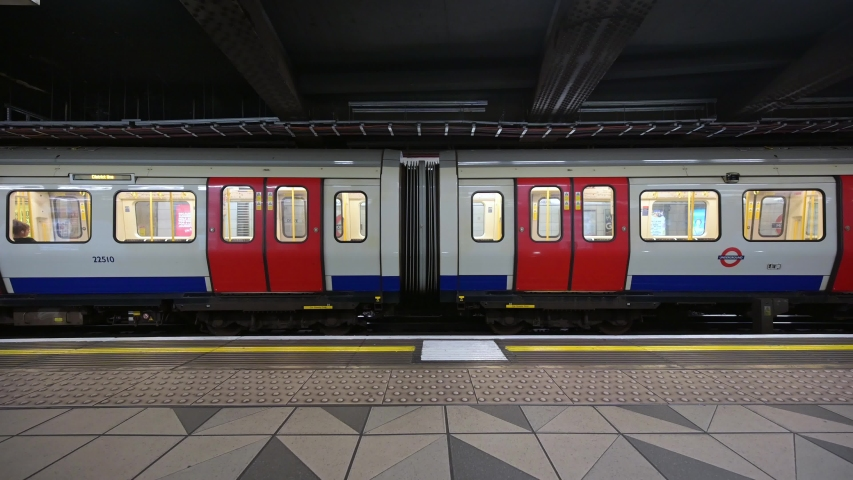 LONDON - AUGUST 21, 2019: A London tube train pulling away from Monument Underground Station