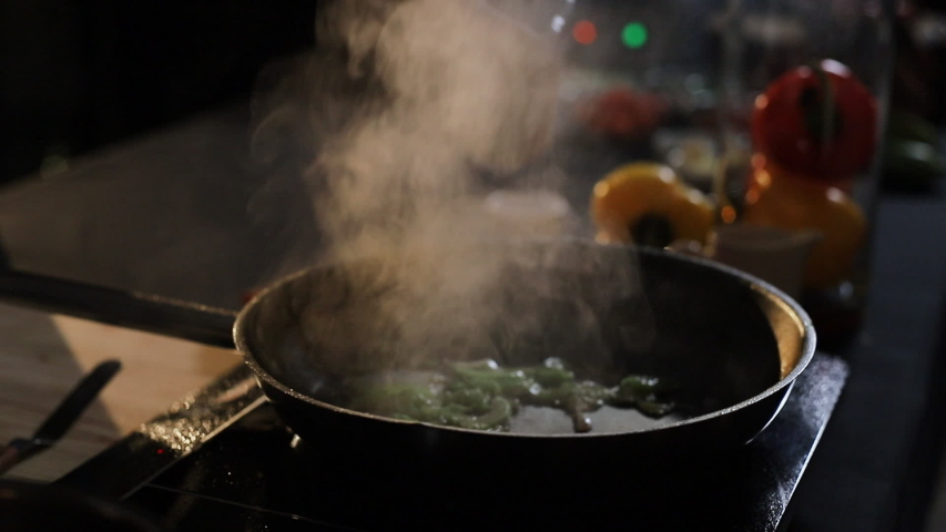 Rying Pan Which Is Poured Into Alcohol And Set On Fire. Food On The Pan Burns. | Shutterstock HD Video #1041945223