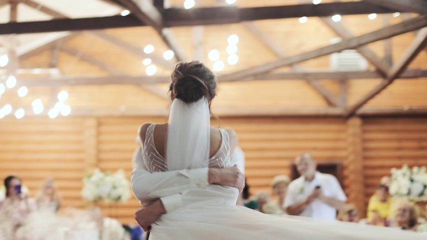 Bride and groom dancing first dance at the wedding party. Feel happy. First wedding dance at the wedding day Royalty-Free Stock Footage #1041945835