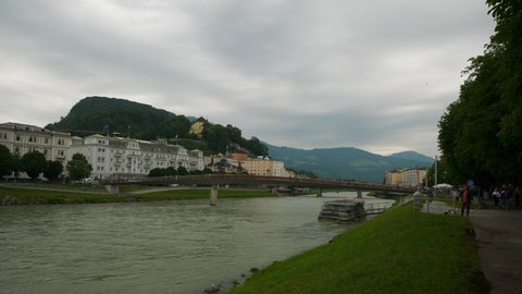 salzburg city day time central riverside park slow motion panorama 4k austria