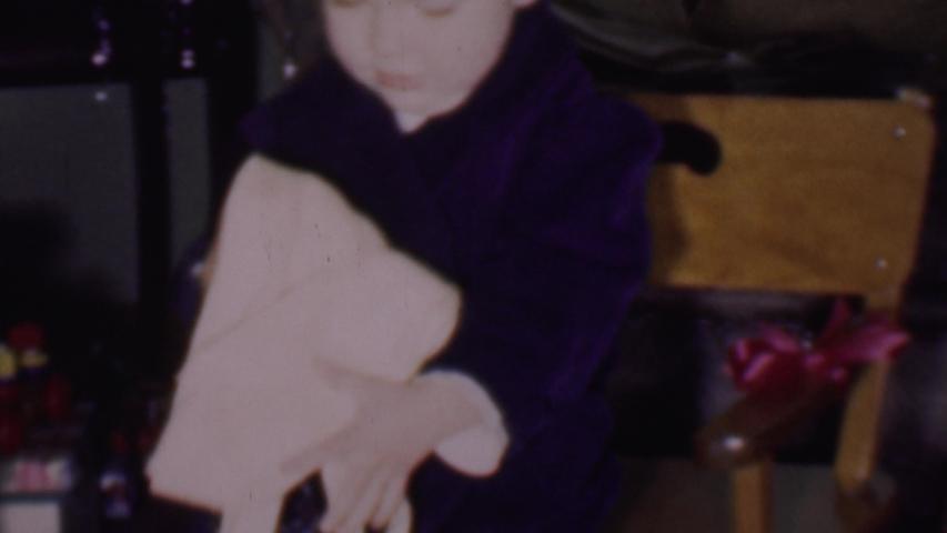 PHOENIX ARIZONA USA-1956: Toddler Organizing Gifts | Shutterstock HD Video #1041973831
