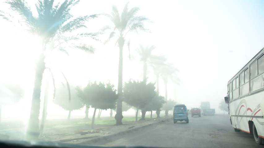 Fasr driving in early morning after sunshine in Cairo Alexandria motor way in Egypt in November 2019ect Object]   Shutterstock HD Video #1041989650