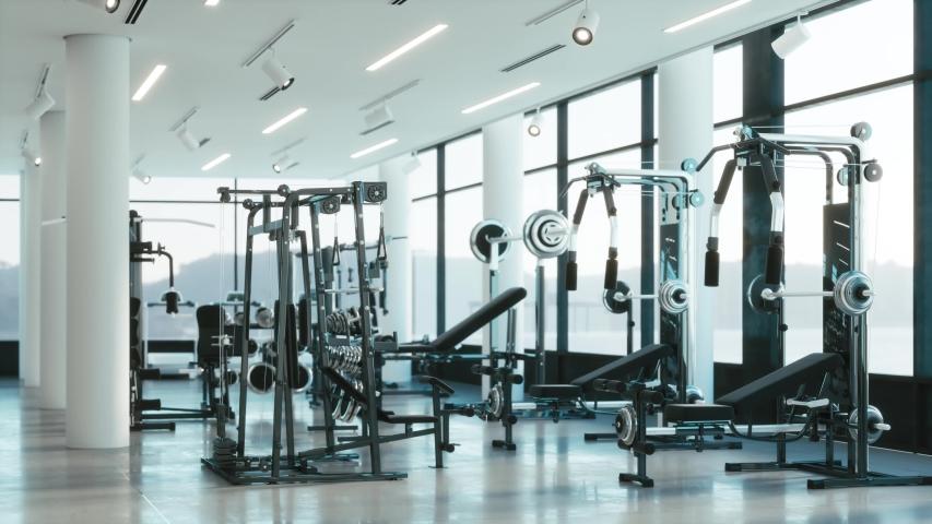 Design and equipment in modern gym. Modern of gym interior with equipment. Sports equipment in the gym | Shutterstock HD Video #1041996484