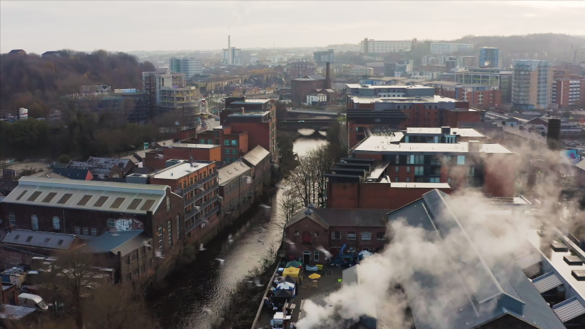 Sheffield, UK - 1st December 2019: Near miss with birds flying around drone above Sheffield City during an early morning sunrise