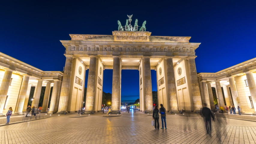 Berlin Brandenburg Gate night Germany  time lapse hyperlapse footage in 4K. Berlin skyline street at night. Berlin skyline at night.