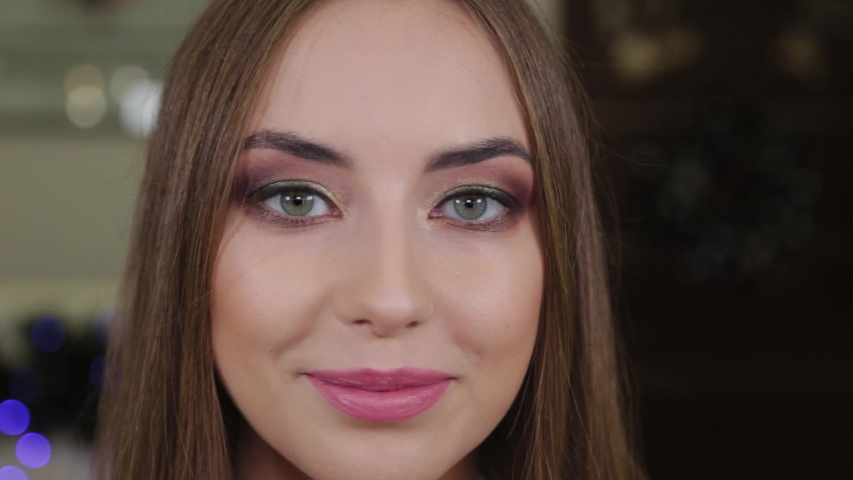Portrait of a beautiful happy girl with make-up in a beauty salon. | Shutterstock HD Video #1042030537