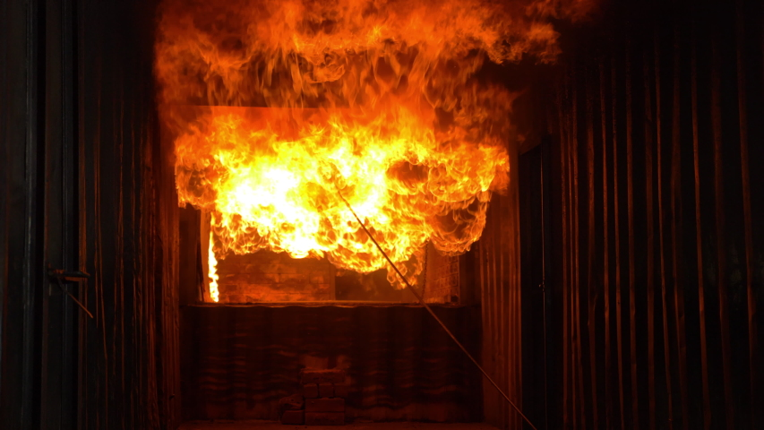 Big real fire of gas and oil explosion bursting through air.The building was burnt down.infernal fire in an industrial factory with big flame and smoke. Looping Fire Flames. Fire wall in slow motion   Shutterstock HD Video #1042065838