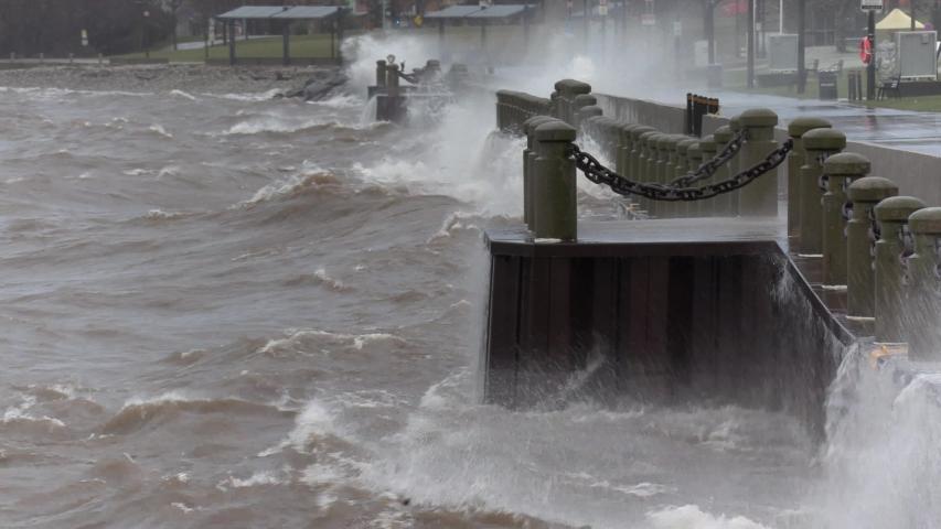 Burlington, Ontario, Canada December 2019 Epic waves hitting urban shoreline in hurricane force winds during storm | Shutterstock HD Video #1042101412