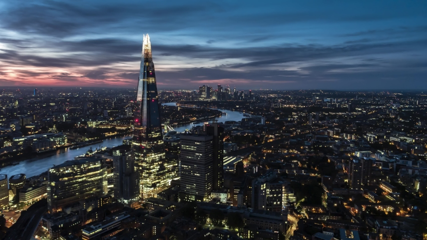Establishing Aerial View of London, City Skyline, Shard and Tower Bridge in foreground, Canary Wharf in background, United Kingdom evening dusk night beautiful sky Royalty-Free Stock Footage #1042116970