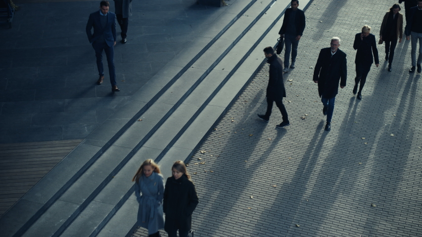 Office Managers and Business People Commute to Work in the Morning or from Office on a Sunny Day on Foot. Pedestrians are Dressed Smartly. Two Businessmen Shake Hands. Footage from Above. | Shutterstock HD Video #1042117507
