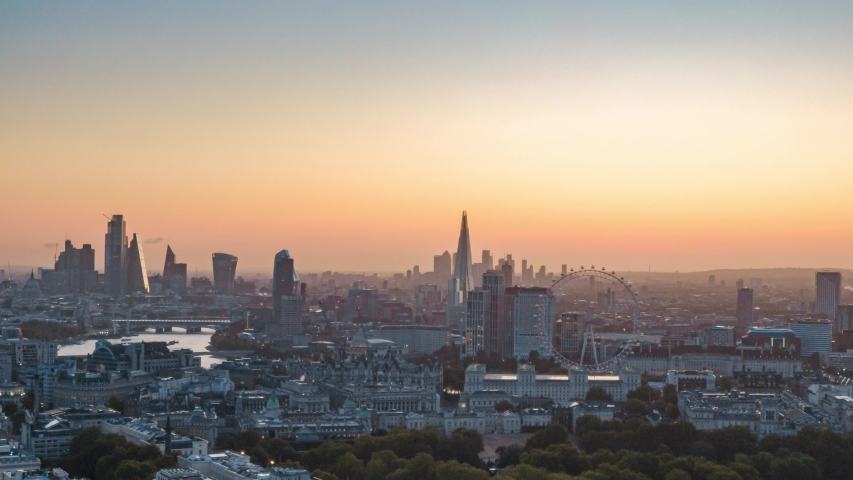 Aerial Drone Helicopter Panoramic View of Sun Rising Over City Of London Skyline London Eye And Thames River Hyper lapse Time Lapse
