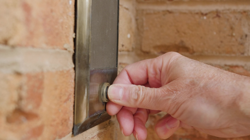 Ringing doorbell with thumb. Closeup of male hand pushing home intercom button. | Shutterstock HD Video #1042154791