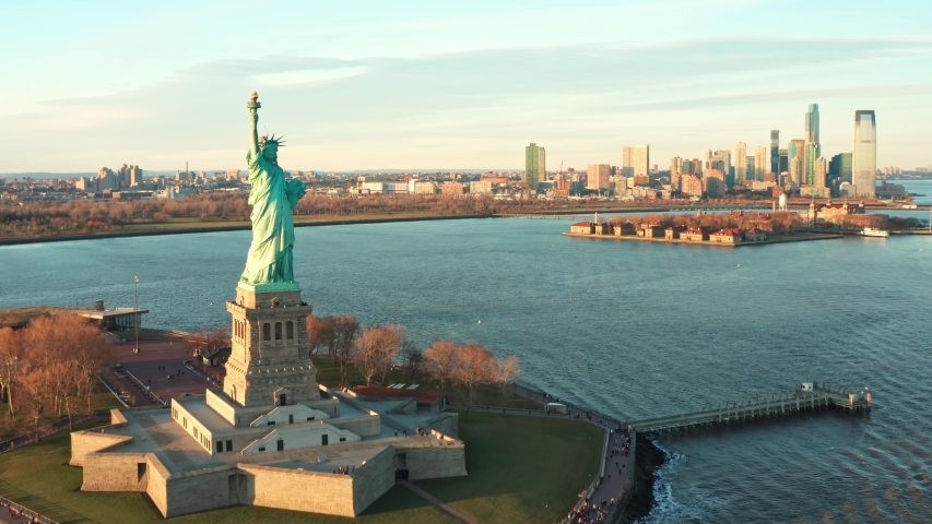 Slow drone rotation around The Statue of Liberty. The Statue of Liberty (Liberty Enlightening the World) is a colossal neoclassical sculpture on Liberty Island in New York Harbor.