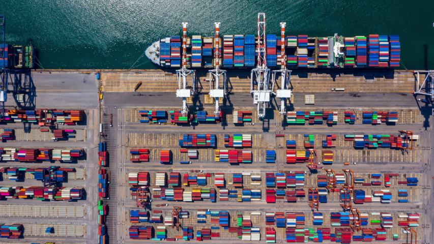 Container ship loading and unloading in deep sea port, Aerial view of business logistic import and export freight transportation by container ship, Container loading cargo freight ship, Time Lapse 4K. Royalty-Free Stock Footage #1042166629